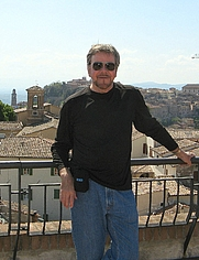 Author photo. Standing on a rooftop in Perugia, Italy, enjoying the day with friends.