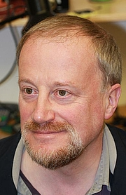 Author photo. Originally from Wikipedia. Portrait of Ross Anderson, Professor of Security Engineering, University of Cambridge Computer Laboratory, 2008, taken by Markus Kuhn.