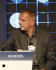Author photo. Scheidel at the World Economic Forum Annual Meeting of the New Champions in 2012 [credit: World Economic Forum]