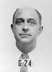 Author photo. Wartime Los Alamos badge photo