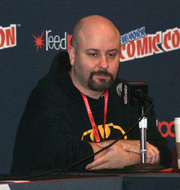 Author photo. Comic book writer and novelist Marc Andreyko speaking on a panel regarding The Illegitimates, the IDW comic book miniseries created by him and actor/comedian Taran Killam, on Sunday, October 13, 2013 at the Jacob K. Javits Convention Center in Manhattan, Day 4 of the 2013 New York Comic Con. This photo was created by Luigi Novi By Luigi Novi, CC BY 3.0, <a href=&quot;//commons.wikimedia.org/w/index.php?curid=30062643&quot; rel=&quot;nofollow&quot; target=&quot;_top&quot;>https://commons.wikimedia.org/w/index.php?curid=30062643</a>