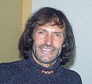Author photo. Hans Kammerlander at a slide show in the Eifel. (c) Thomas Mitterer