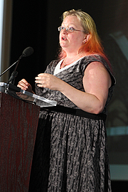 """Author photo. Seanan McGuire gives a presentation on the Fiction Stage at the National Book Festival, August 31, 2019. Photo by Ralph Small/Library of Congress. By Library of Congress Life - 20190831RS0179.jpg, CC0, <a href=""""https://commons.wikimedia.org/w/index.php?curid=82899238"""" rel=""""nofollow"""" target=""""_top"""">https://commons.wikimedia.org/w/index.php?curid=82899238</a>"""