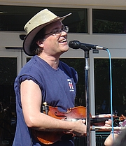 Author photo. Lead singer Gordon Gano, concert at UCSD, Jan. 31, 2006 (photo credit: wikipedia user CharlesCA)