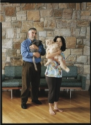"Author photo. Robin Wells and husband Paul Krugman, with their cats. Photo by Tina Barney for <a href=""http://www.newyorker.com/reporting/2010/03/01/100301fa_fact_macfarquhar"" rel=""nofollow"" target=""_top"">The New Yorker</a>."