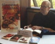"""Author photo. By Christopher Fulbright - Christopher Fulbright took this photograph at FenCon in Dallas, Texas, in September 2012, of me signing my books at the autograph table. Christopher Fulbright then later gave me this photograph to use as I wished., Public Domain, <a href=""""https://commons.wikimedia.org/w/index.php?curid=24275880"""" rel=""""nofollow"""" target=""""_top"""">https://commons.wikimedia.org/w/index.php?curid=24275880</a>"""
