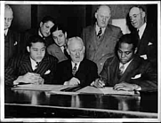 Author photo. John Henry Lewis (right), Boxing Commissioner John Phelan (center), and Joe Louis (left) before the 1939 Madison Square Garden fight. / Photo © <a href=&quot;http://www.bildarchivaustria.at&quot;>ÖNB/Wien</a>
