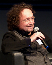 """Author photo. Bernhard Hennen during a literary reading at the first annual convention of the Phantastik-Autoren-Netzwerk PAN in Cologne, 2016. By DianeAnna - Own work, CC BY-SA 4.0, <a href=""""//commons.wikimedia.org/w/index.php?curid=52353304"""" rel=""""nofollow"""" target=""""_top"""">https://commons.wikimedia.org/w/index.php?curid=52353304</a>"""