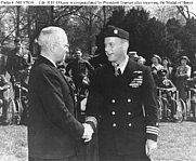 Author photo. O'Kane is congratulated by President Truman, after he had been presented with the Medal of Honor in ceremonies on the White House lawn, 27 March 1946.