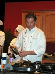 Author photo. Bobby Flay performing a cooking demonstration in Green Bay, Wisconsin by Larkworb