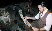 Author photo. Gris Grimly reading Grimericks to the monsters of Netherworld Haunted House.
