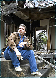 Author photo. Jayme Lynn Blaschke, author of INSIDE THE TEXAS CHICKEN RANCH: THE DEFINITIVE ACCOUNT OF THE BEST LITTLE WHOREHOUSE, at the ruins of the titular defunct brothel.