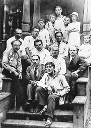 Author photo. Der Nister (front center) sitting behind Marc Chagall at the Malakhovka Jewish boys refuge