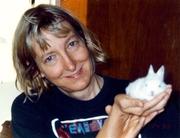 Author photo. Carol J. Adams with Snowball [credit: Carol J. Adams]