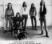 "Author photo. Publicity photo of Janis Joplin and Big Brother and the Holding Company. By Albert B. Grossman. His management information is shown on the identical, autographed copy of the image. - eBay itemphoto frontphoto backeBay item used for comparison-identical photoidentical photo, Public Domain, <a href=""https://commons.wikimedia.org/w/index.php?curid=17193105"" rel=""nofollow"" target=""_top"">https://commons.wikimedia.org/w/index.php?curid=17193105</a>"