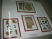 Author photo. Fragments of the scrolls on display at the Archeological Museum, Amman. Photo taken by Gary Jones, Dec. 2002