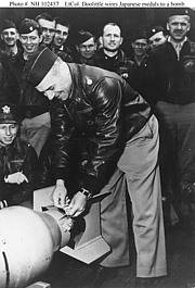"""Author photo. Doolittle wires a Japanese medal to a bomb, for """"return"""" to its originators in the first U.S. air raid on the Japanese Home Islands, April 1942. (history.navy.mil)"""