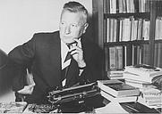 Author photo. The author Klaas Norel behind his desk