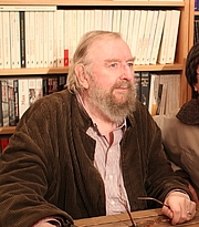 """Author photo. Michael Moorcock à la librairie Charybde, Paris, France, le 14/10/2012 By Rmdolhen - Own work, CC BY-SA 3.0, <a href=""""https://commons.wikimedia.org/w/index.php?curid=22073486"""" rel=""""nofollow"""" target=""""_top"""">https://commons.wikimedia.org/w/index.php?curid=22073486</a>"""