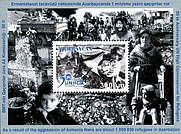 Author photo. Souvenir sheet of Azerbaijan, 2001. 50th anniversary of the UN High Commissioner for Refugees. The refugees under the Armenia aggression and the tent small town are pictured on the souvenir sheet.