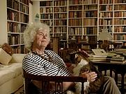 Author photo. Jan Morris, books and cat.