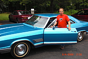 Author photo. Author William Scalin standing next to a classic Buick Wild cat.