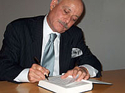 Author photo. Jeremy Rifkin (1945-    ) signing a book after his lecture at Amerika Haus, Frankfurt, Germany on Sept. 15, 2004 <a href'&quot;http://frankfurt.usconsulate.gov/frankfurt/rifkin.html&quot;>U.S Consulate, Frankfurt, Germany</a>